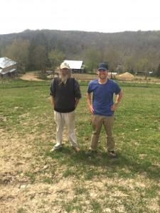 The Barefoot Farmer, Jeff Poppen, left, and Chris Morina, intern, tend to Poppen's 250-acre farm in Red Boiling Springs. Photo/Liz Engel