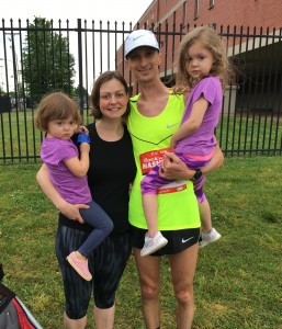 Brian Shelton celebrates post-run with his family, from left, Stella (2), wife Lori, and Emily (4).