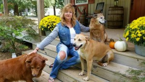 Angie Goodwin, Friends of White County Animals board member, with her rescue dogs Foxy, Teddy, and Simon. Photo submitted