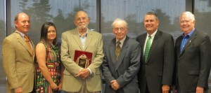 Honoring Dr. Sam Barnes with the annual Fred H. Roberson Award are, from left, Wes and Jessica Roberson; Barnes; Bill Roberson; Cookeville Regional Medical Center CEO Paul Korth; and Bob Bell, CRMC board of trustees vice chairman.