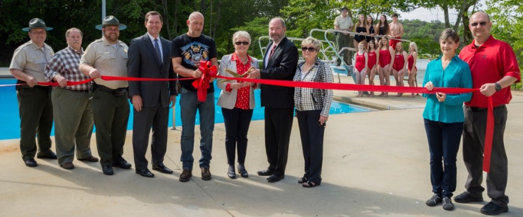 Tennessee State Parks leaders, along with community members, celebrated the completion of renovations to the Village Green pool area at Fall Creek Falls. Picture are, from left, Mike Robertson, director of operations, Tennessee State Parks; Rodgers Spencer, Upland Design Group; Andy Wright, interim Fall Creek Falls manager; Rep. Cameron Sexton; Dan Goney, Van Buren-Spencer Chamber of Commerce; Sen. Janice Bowling; Brock Hill, deputy commissioner, TDEC; Marilyn Baker, executive director, Van Buren-Spencer Chamber; Diann Goney, Van Buren-Spencer Chamber; and Ronnie Hitchcock, Village Green concessions. In the background is Park Ranger Robin Bayless and 2016 Village Green pool lifeguard staff. Photo/Cara Alexander