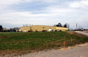Crossville businessman Butch Smith's company Forbus Investments LLC owns the building in the background, and the Crossville city council recently approved his purchase of a 9-acre lot in the foreground. Smith plans to build a 50,000-square-foot spec industrial building on the property.