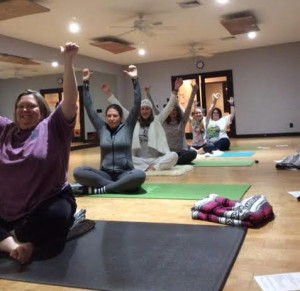 Synergy students, from front, Sheri Brimm, Christian Hart, instructor Stephanie Chance, Petti Groth, Katherine Chapman, and Jenny Haggerty practice Kundalini yoga.  The public is invited to attend a free two-hour yoga practice on International Day of Yoga on Tuesday.