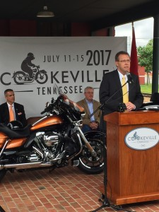 Putnam County Executive Randy Porter, at podium, Cookeville Mayor Ricky Shelton, back left, and Tennessee Department of Tourist Development Commissioner Kevin Triplett announce the Southern Backroads Harley Owners Group Rally event in 2017. UCBJ Photo/Jay Albrecht