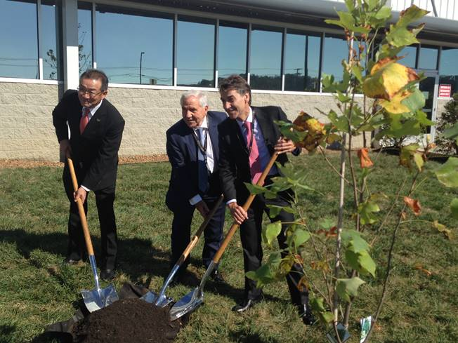 From left, Masahisa Shibata, Panasonic Corp.; Jose Maria Pujol, president of Ficosa; and Javier Pujol, CEO, Ficosa, participate in a tree planting ceremony at the Cookeville factory during a celebration in October.