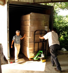 Julian Mast, left, and Ryan Mast unloaded a semi truck full of glass bottles at Sunrise Dairy in Cumberland County. UCBJ Photo/Jim Young