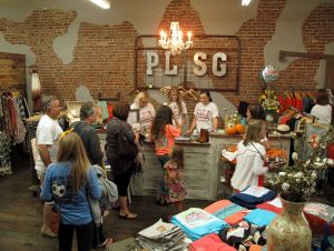 Shoppers crowd Pearls Lace and Southern Grace during a recent Friday at the Crossroads event.
