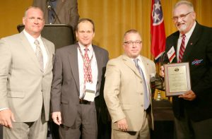 Averitt Express was recently honored by the Tennessee Trucking Association with its 2016 Clean Diesel Award as well as its 2016 Fleet Safety Award. Accepting the honors on behalf of Averitt are director of safety and compliance John Walton, second from left, and driving associate Robert Crabtree, right, who also serves as a TTA Road Team Captain.