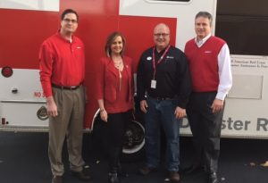 Red Cross of East Tennessee board member Lori Tucker, second from left, and Red Cross of Northeast Tennessee board member Clark Parker, second from right, thank Averitt Express' Keith Davis, left, and Bryan Snyder, right, for Averitt's recent $10,000 donation.