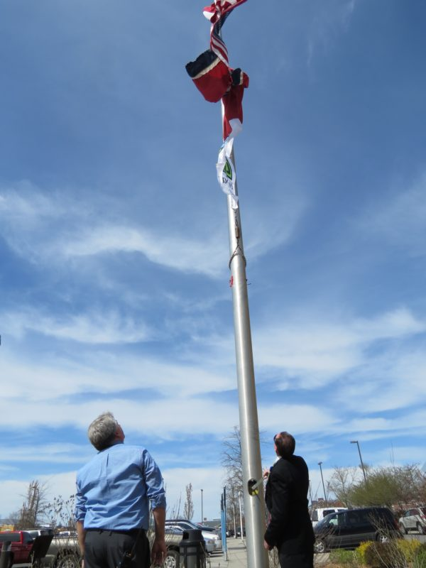 Michael Hellman, CRMC, and Scott Lethi, chief nursing officer at CRMC, raise the Donate Life Month flag to honor organ and tissue donors the month of April.