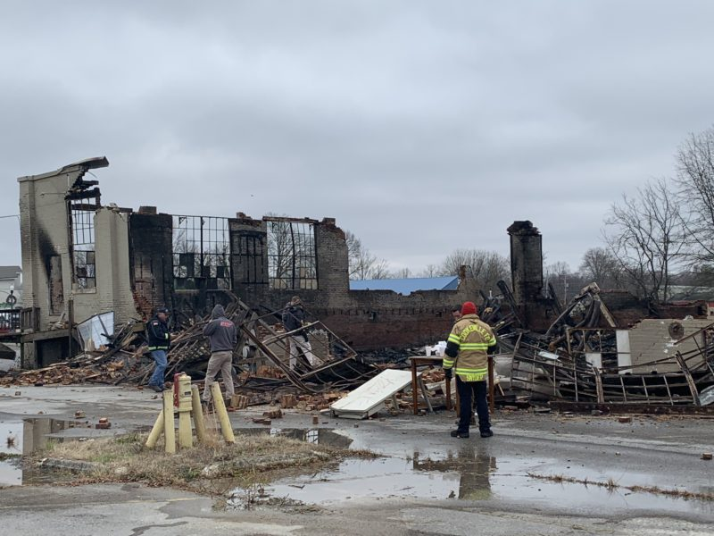 State and local officials inspect the fire scene.
